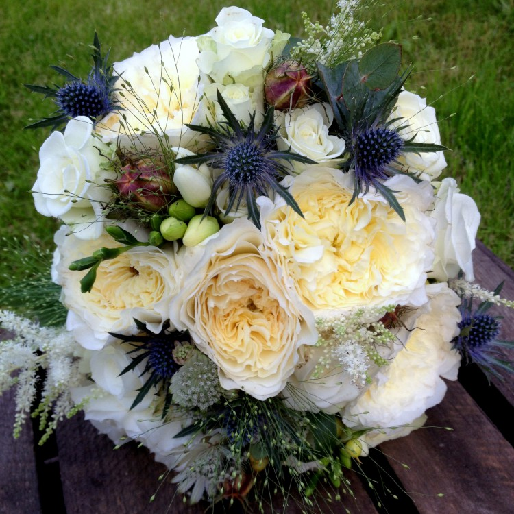 cream rose and thistle brides bouquet