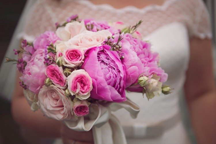 brides bouquet of pink peonies and roses