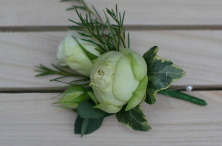 rose buttonhole for the groom