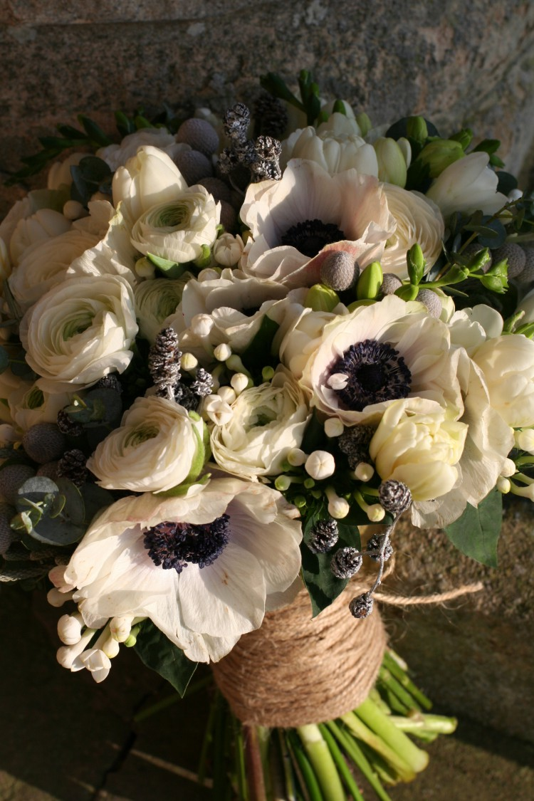 winter bridal bouquet with anemones and ranunculus