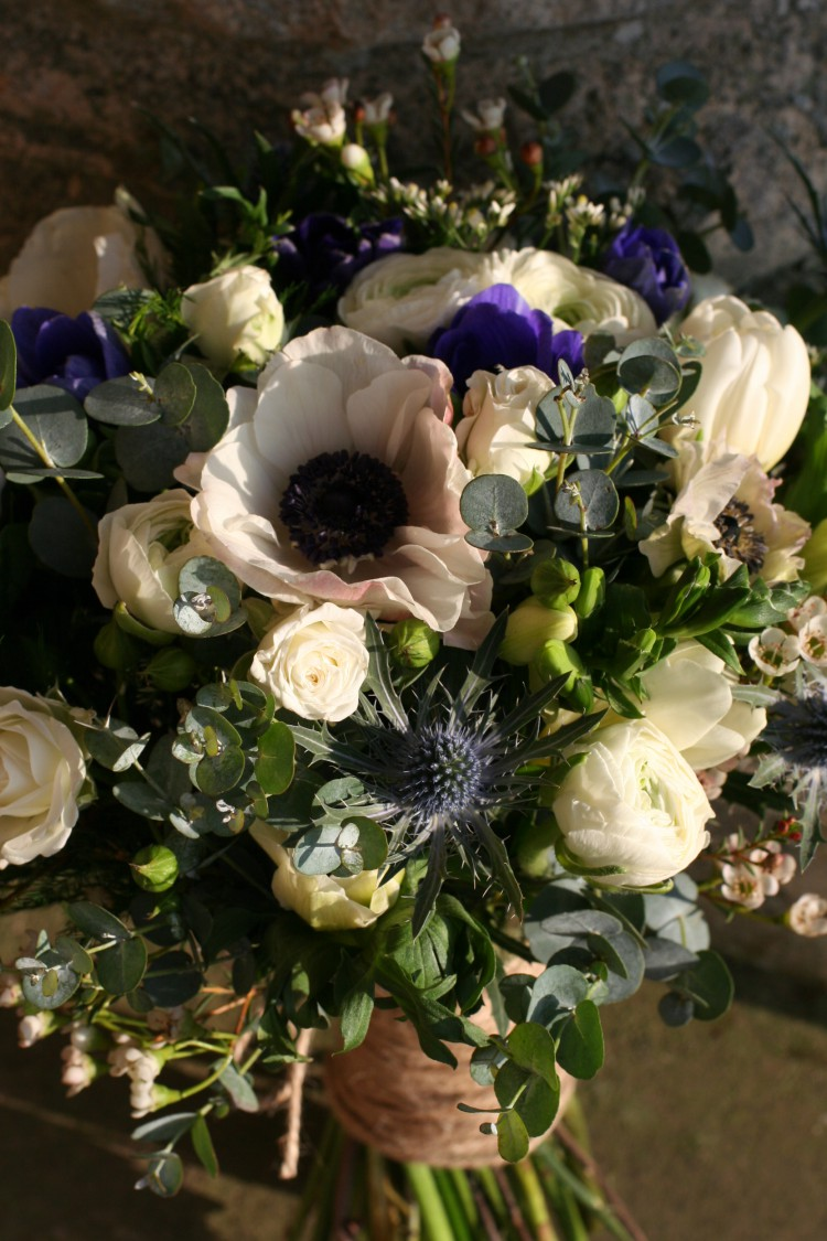 winter bridesmaids bouquet with anemones ranunculus and thistles