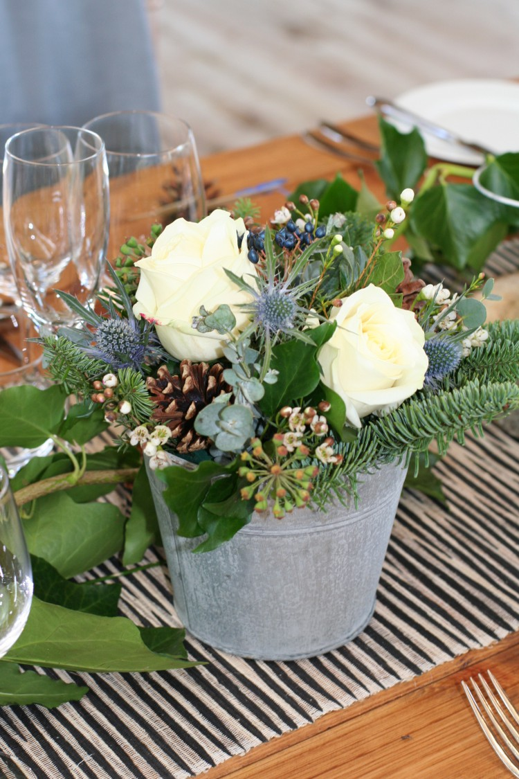 winter table arrangement in galvanised bucket