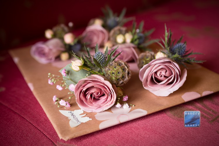 pink rose and thistle buttonholes
