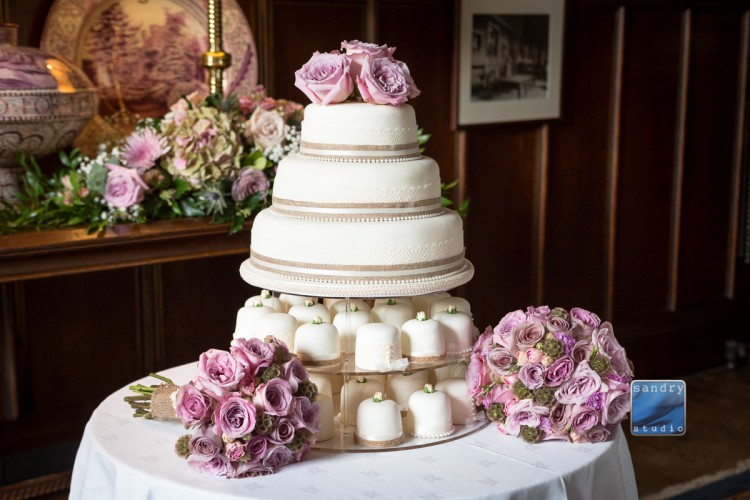 bouquets and wedding cake at Eastnor castle
