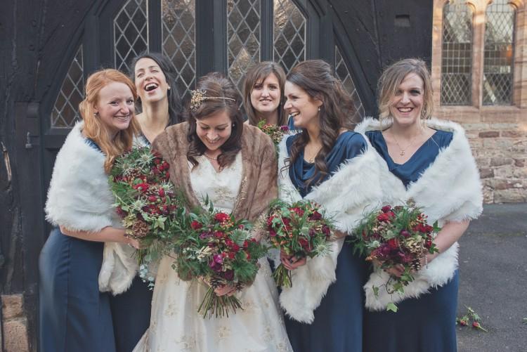 bride and bridesmaids rustic winter wedding