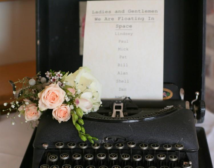 Vintage typewriter with flowers