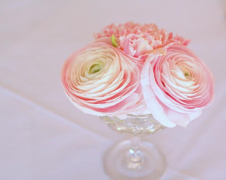 blush pink ranunculus in vintage cut glass vases