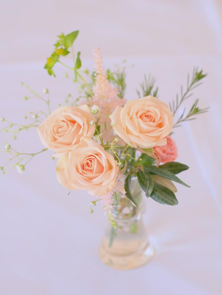 spray roses in cut glass vase