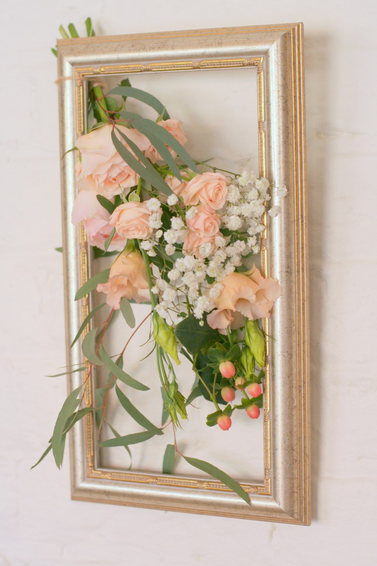 flowers in a vintage picture frame