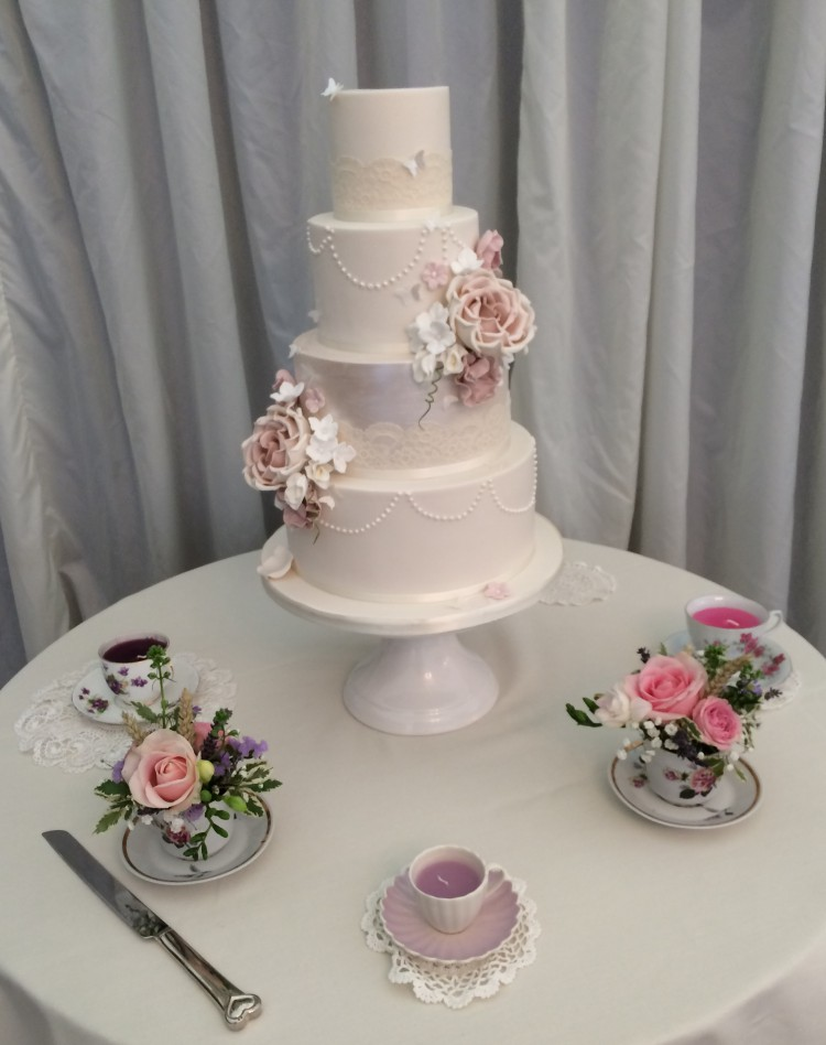tea cup flowers and wedding cake