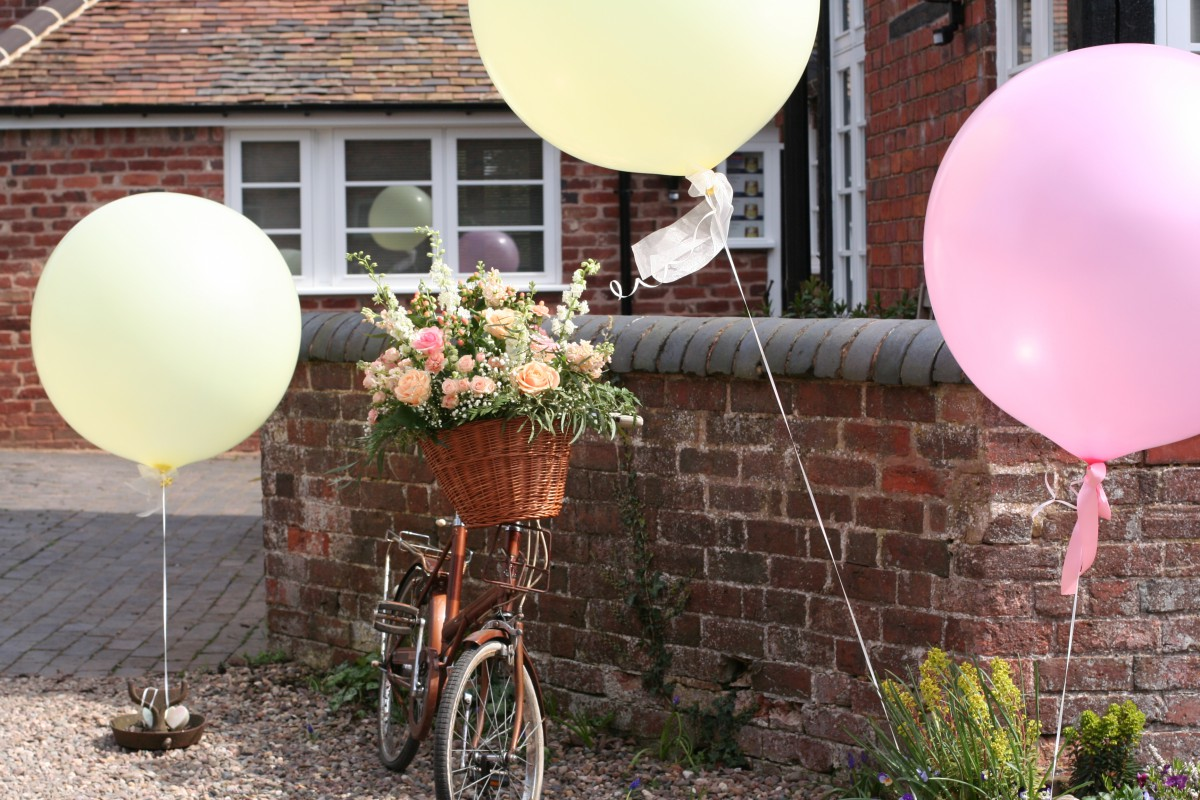 vintage bicycle with flowers and balloons