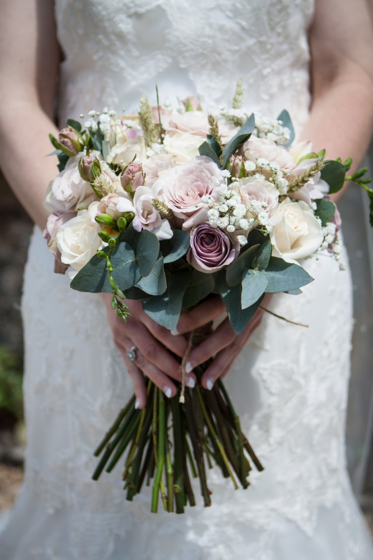 brides bouquet with roses and gypsophila