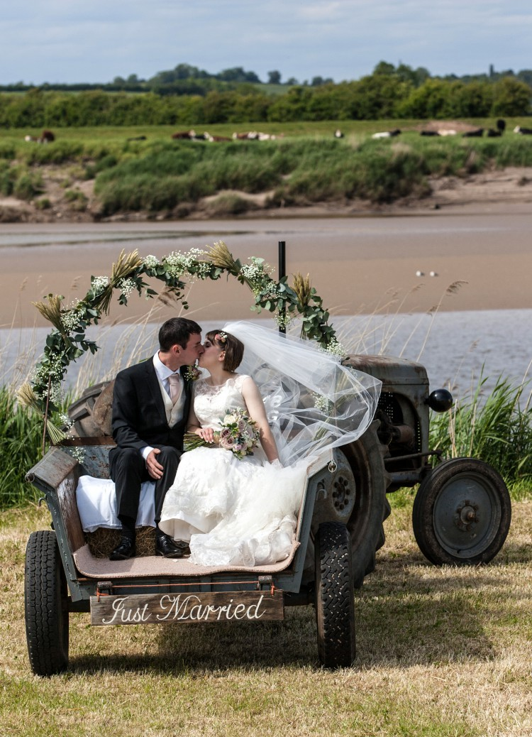 vintage tractor with floral arch