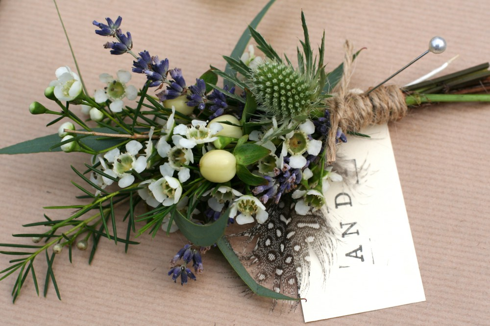 rustic thistle and feather buttonhole