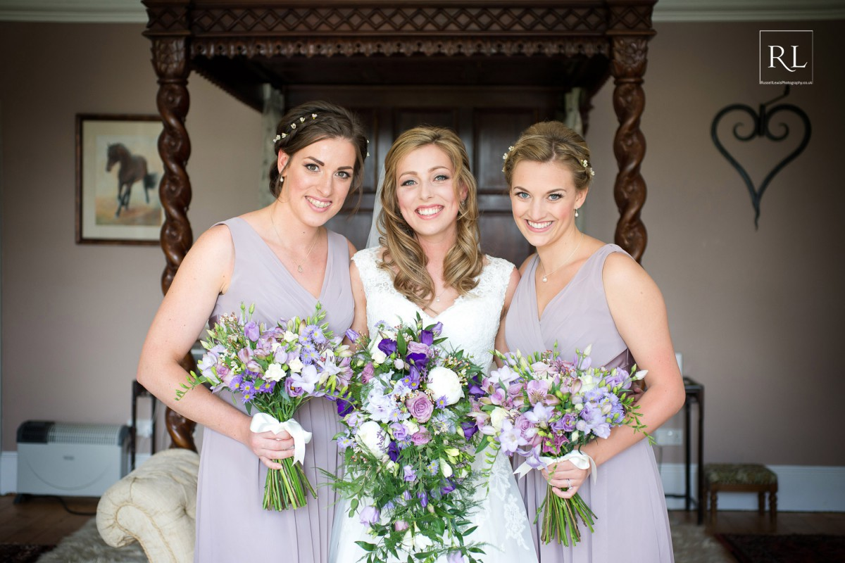 purple wedding flowers for bride and bridesmaids