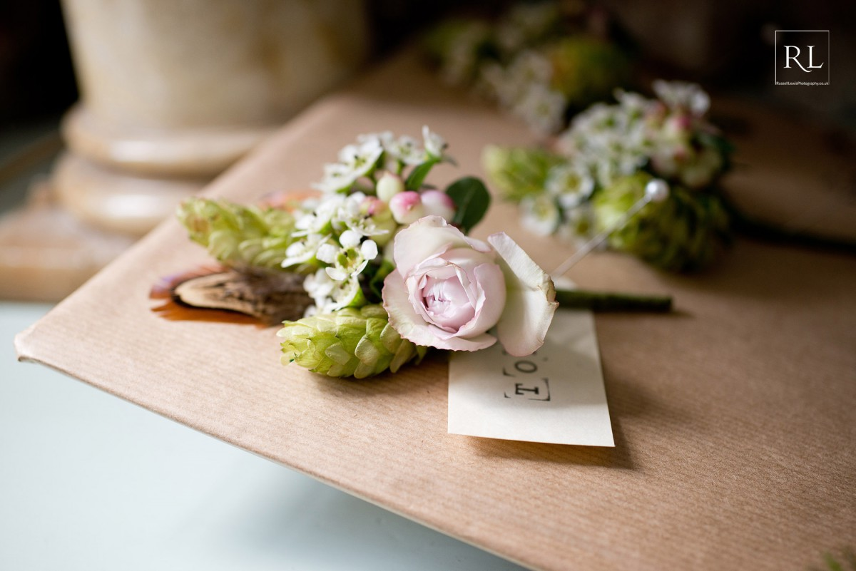 rose, hop and feather buttonhole at Homme House