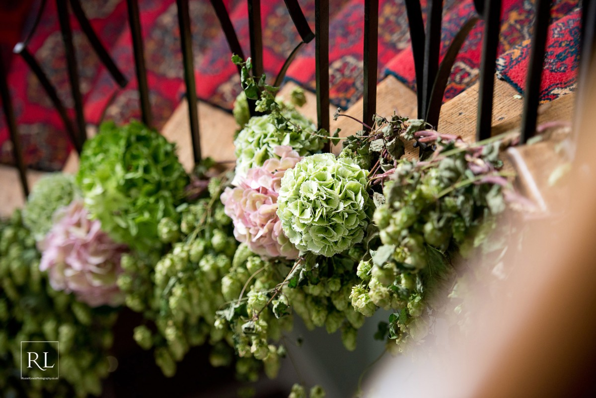 hop and hydrangea garland on staircase at Homme House
