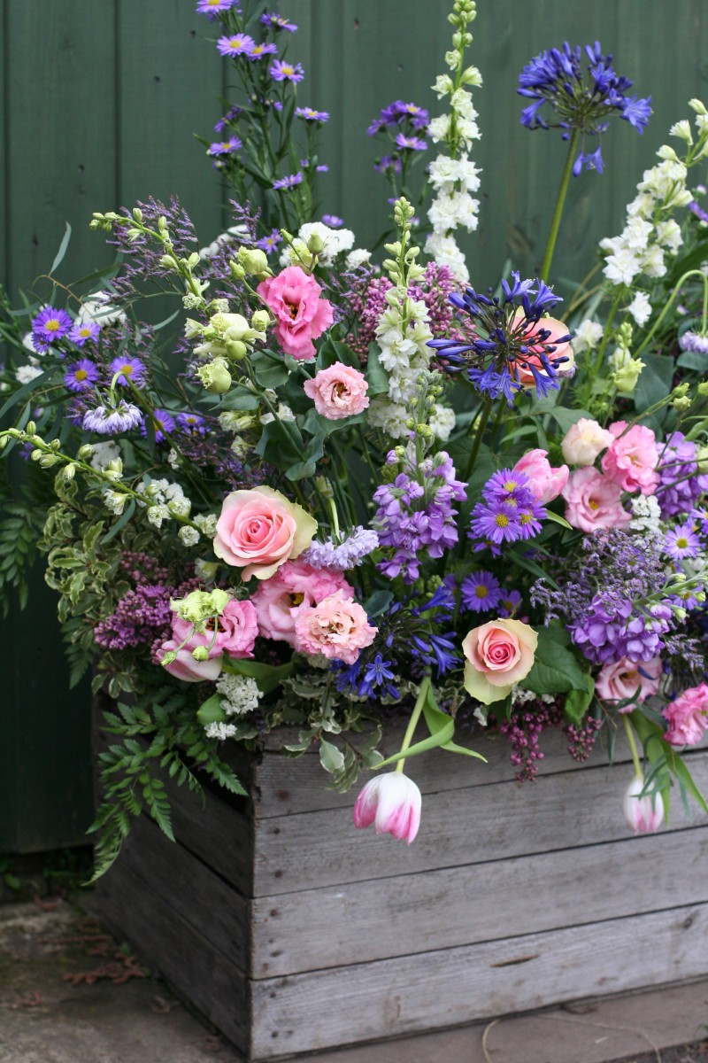 rustic vintage apple crate with Spring flowers