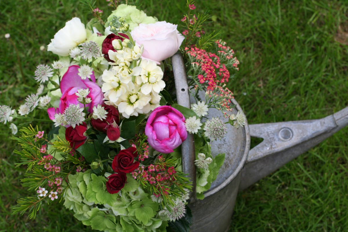 rustic vintage watering can flowers