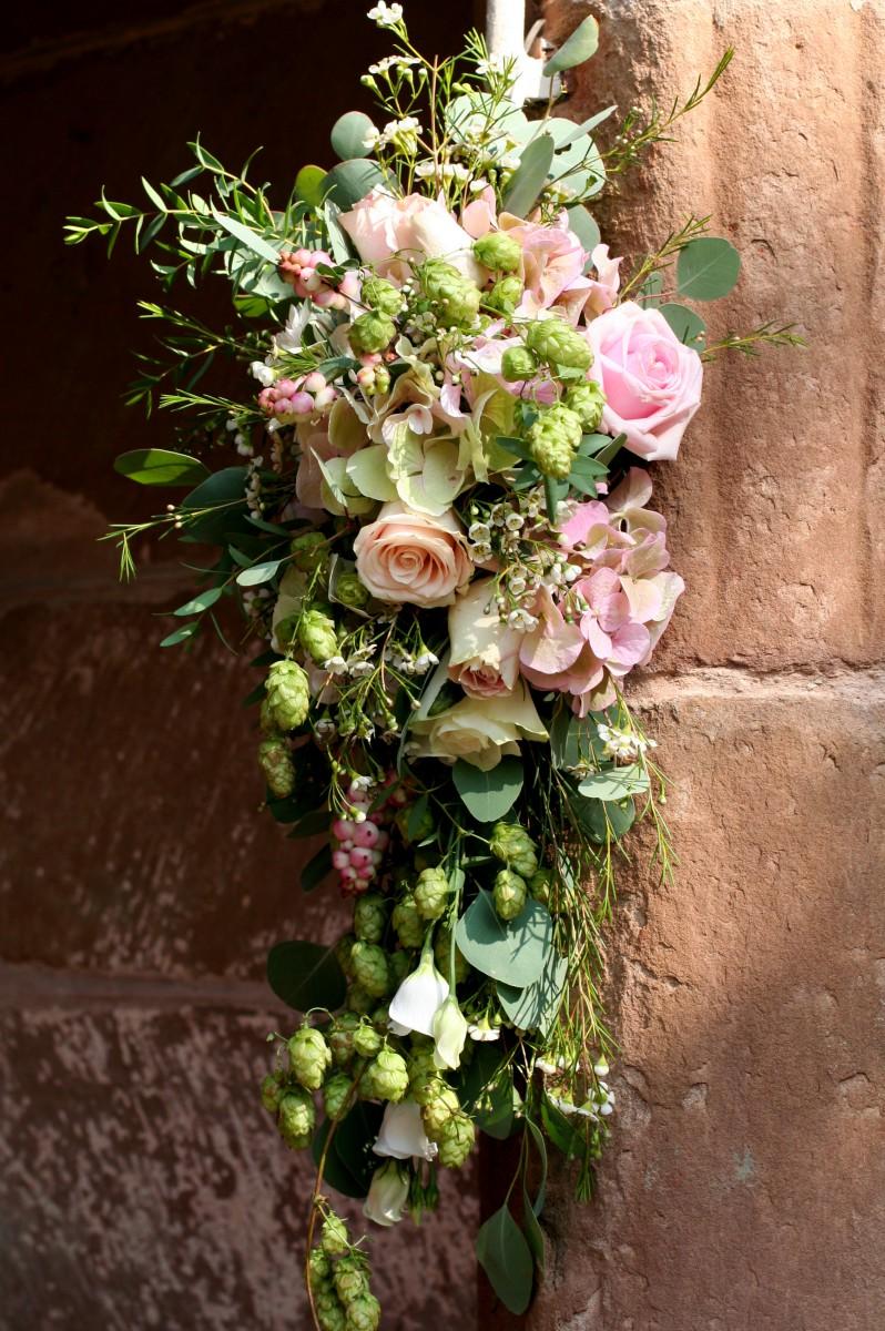 entrance wedding flowers at St Bartholomews church Homme House
