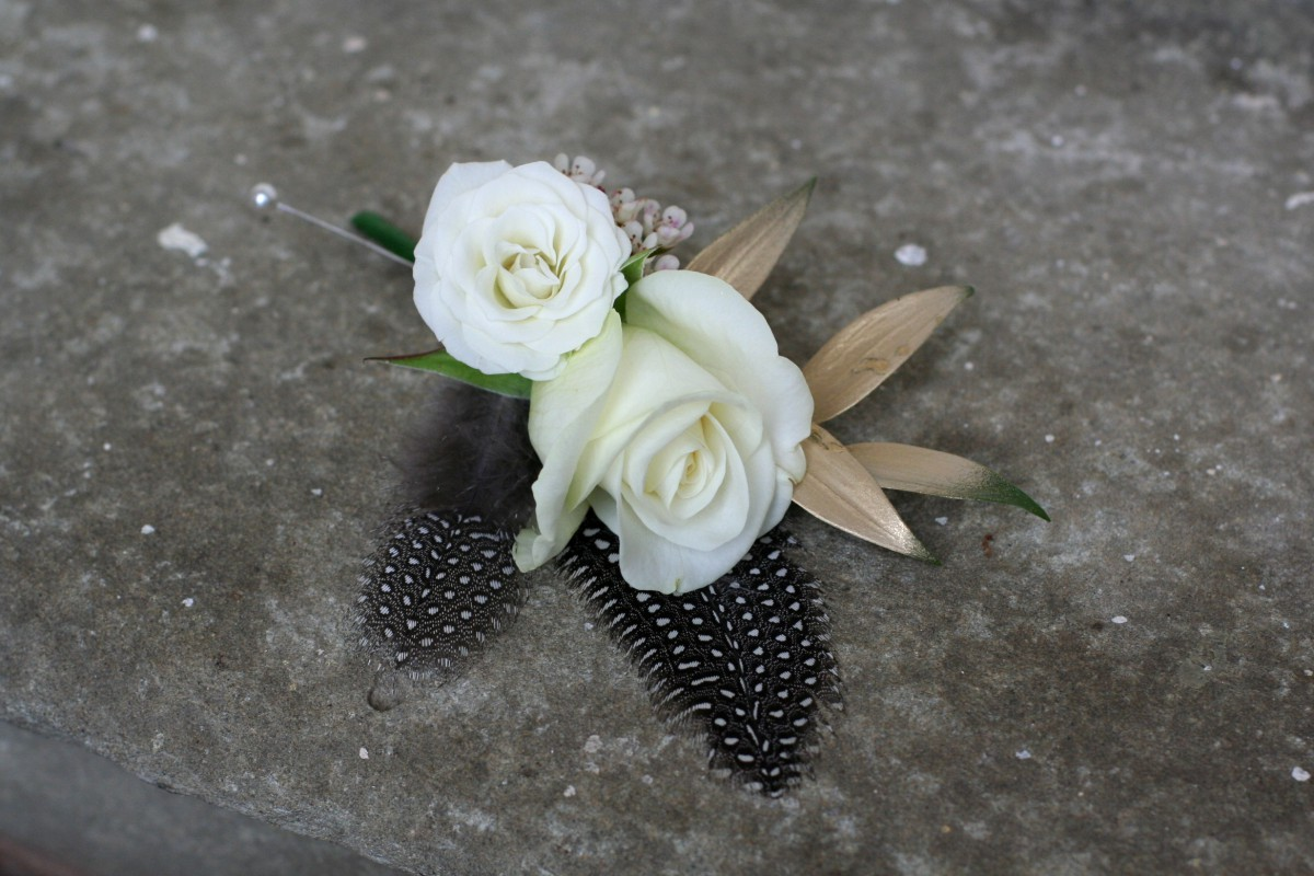 buttonhole with gold foliage and feathers for a Gatsby inspired wedding