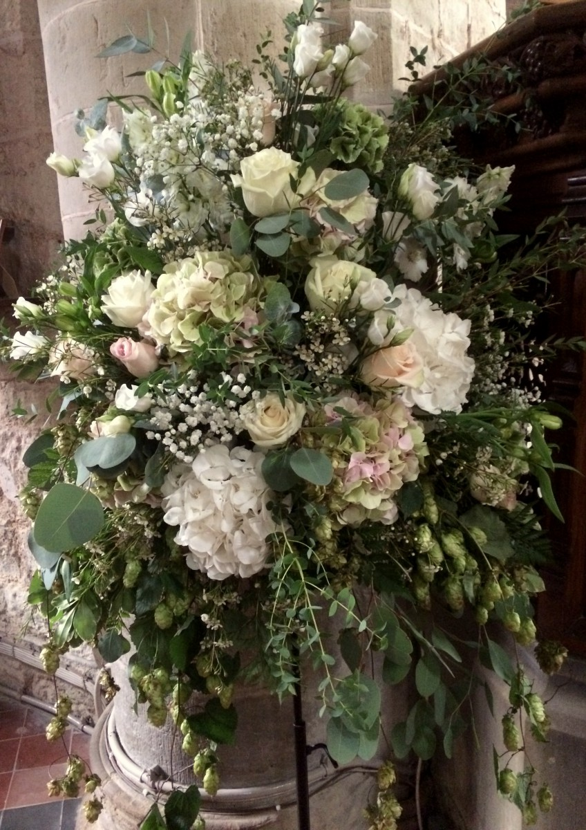natural pedestal arrangement wedding flowers at St Bartholomews church Homme House