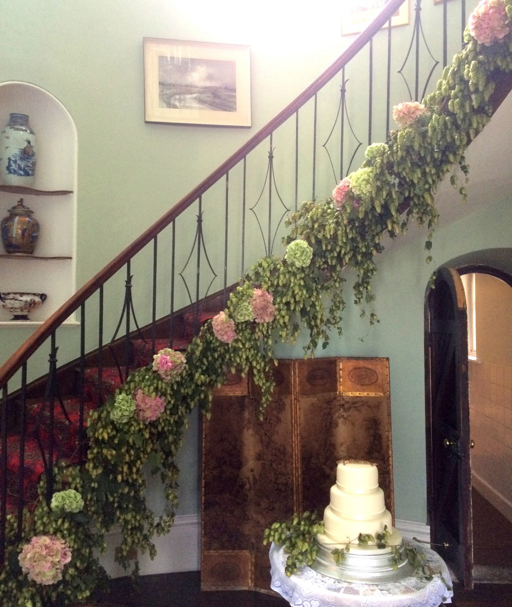 Hop and hydrangea staircase garland wedding flowers at Homme House