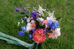 wild and whimsical brides bouquet with peonies and feathers