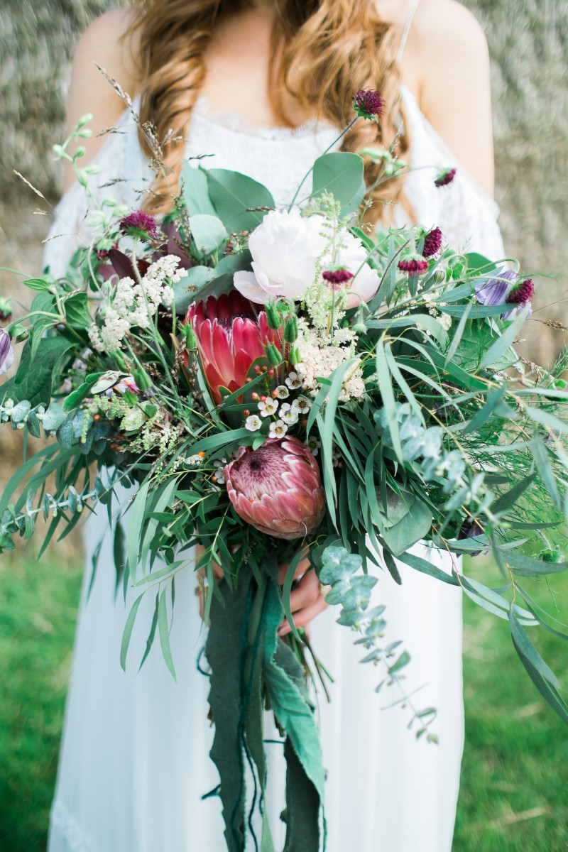 wild whimsical brides bouquet for a festival wedding