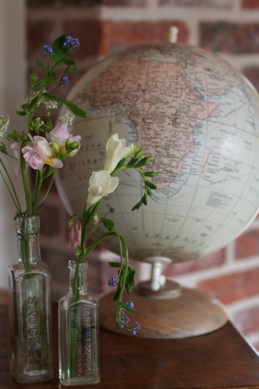 vintage globe and glass bottles