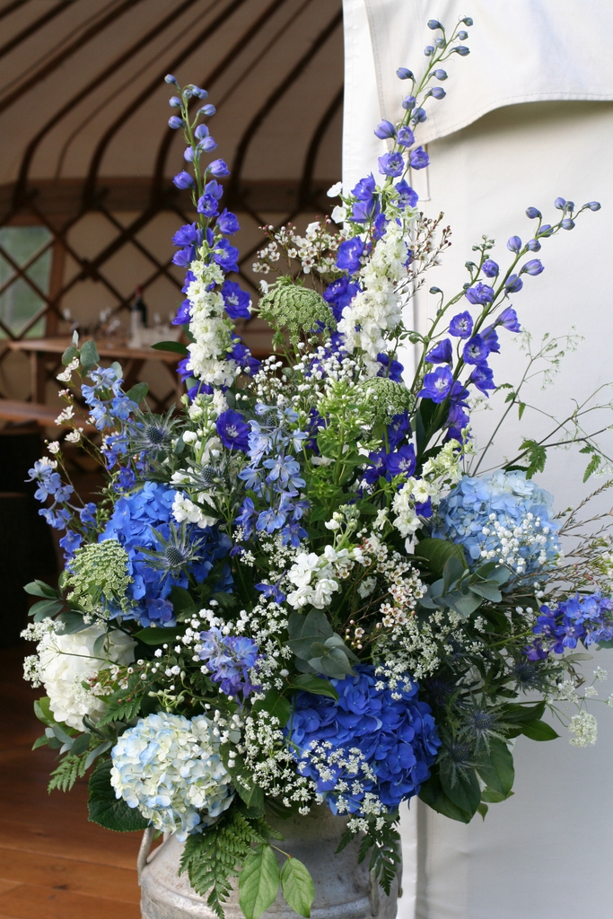 blue and white churn arrangement
