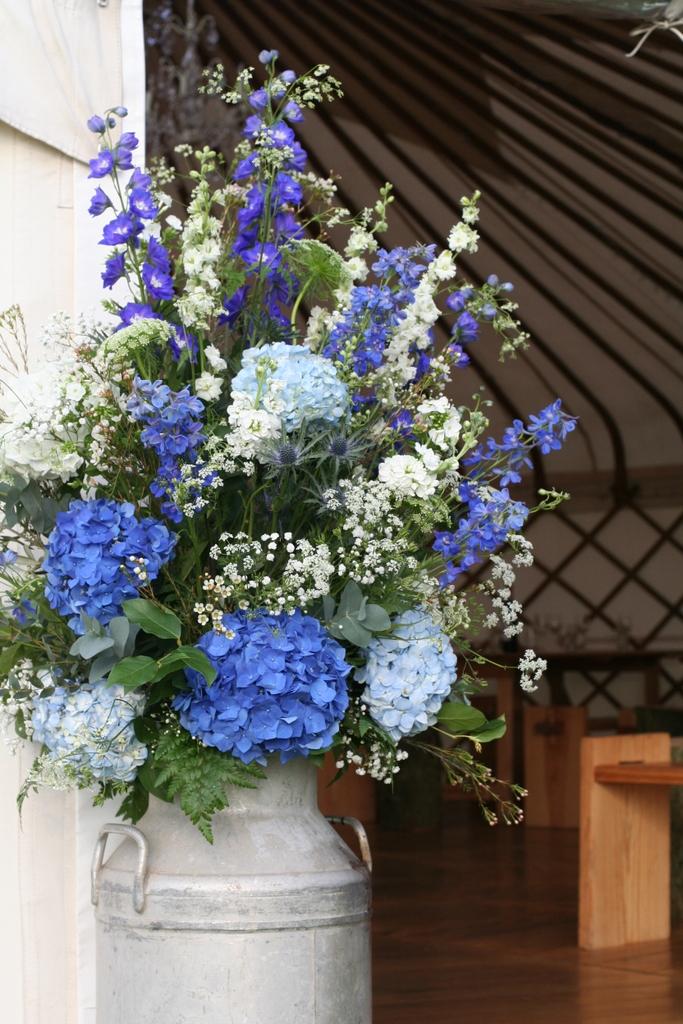 blue and white churn arrangement for a yurt wedding