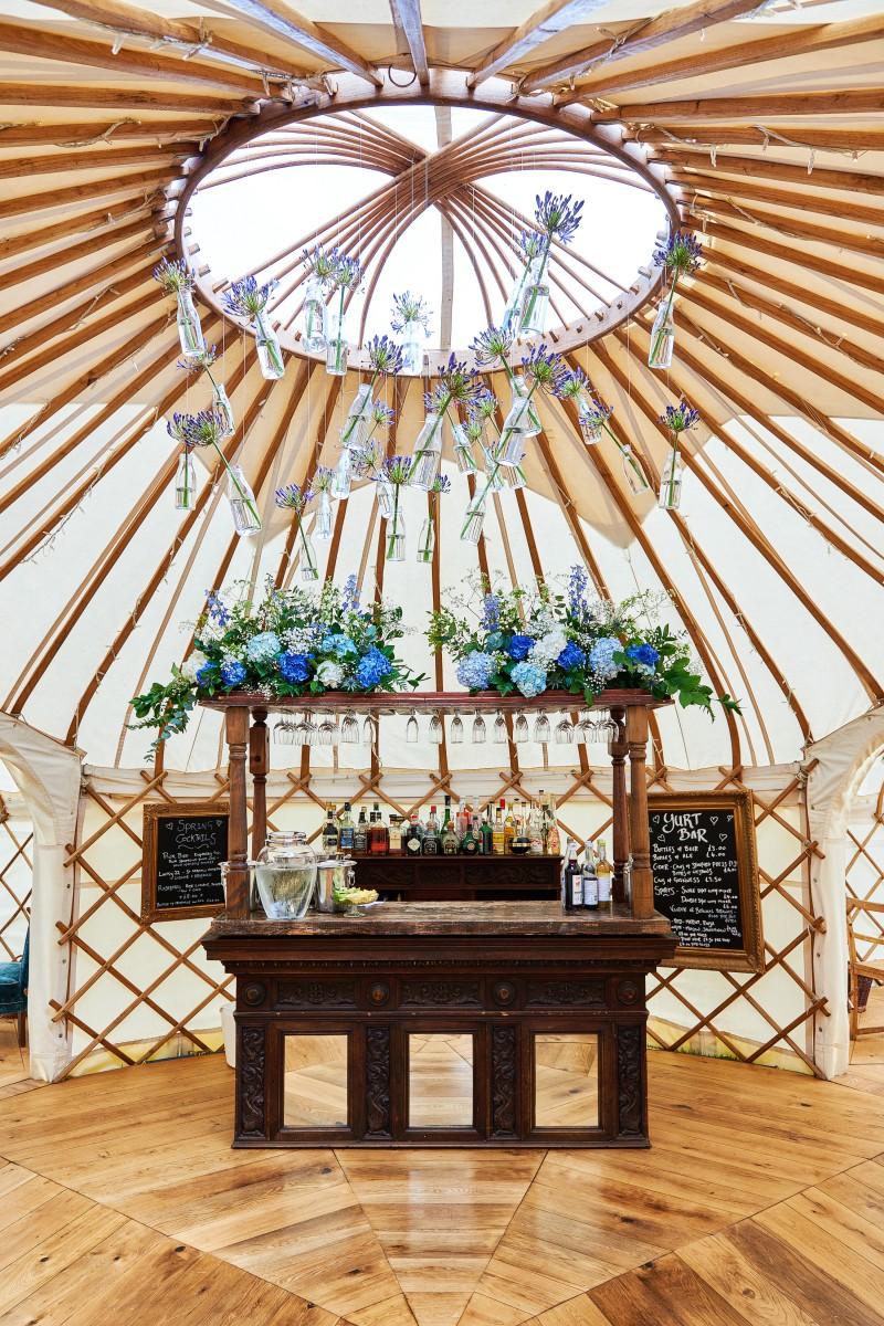 blue and white yurt wedding