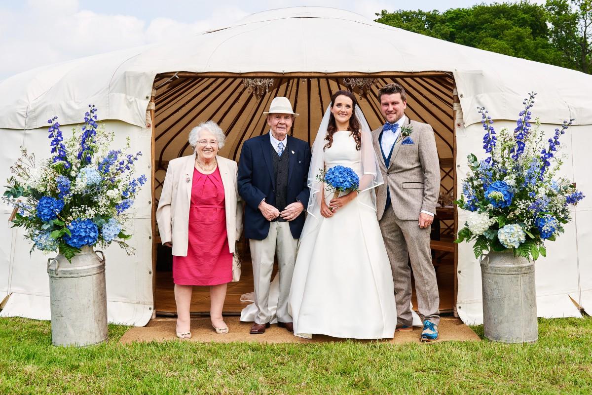 blue and white yurt wedding flowers