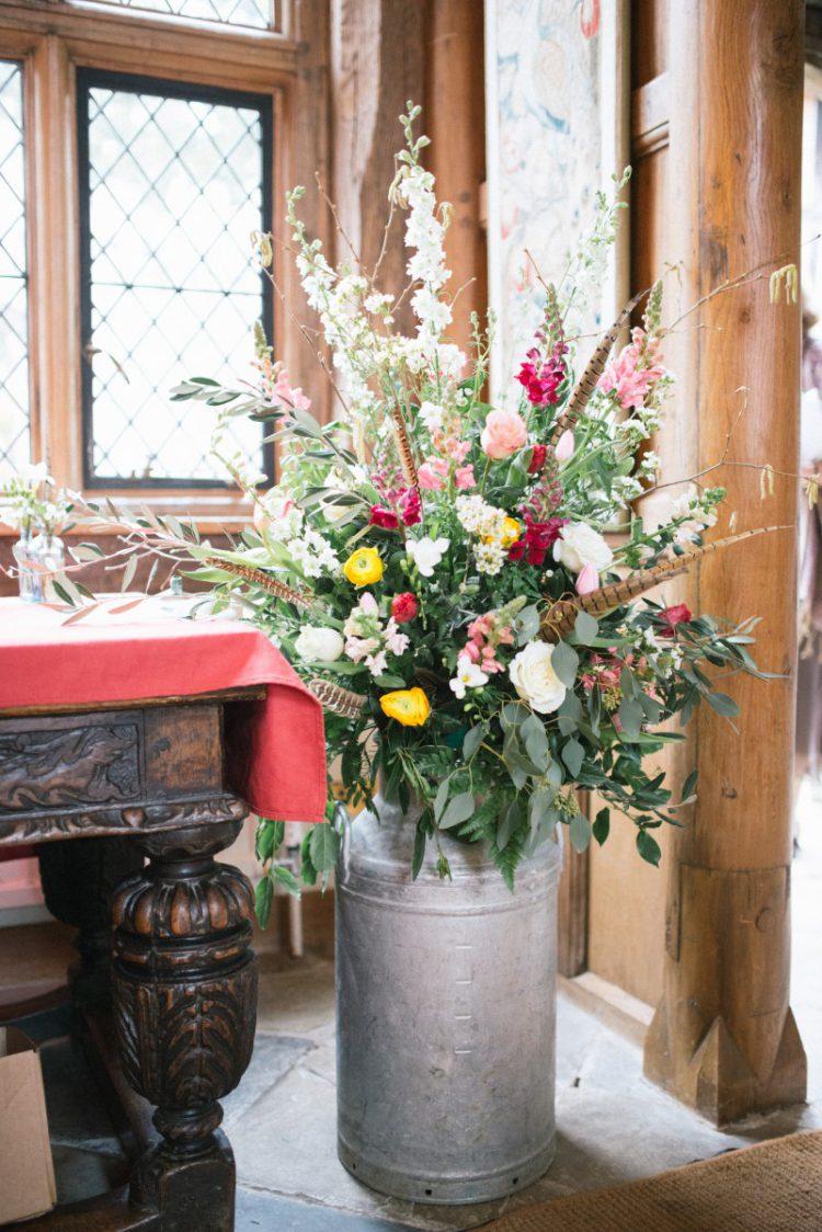 Spring wedding milk churn flowers