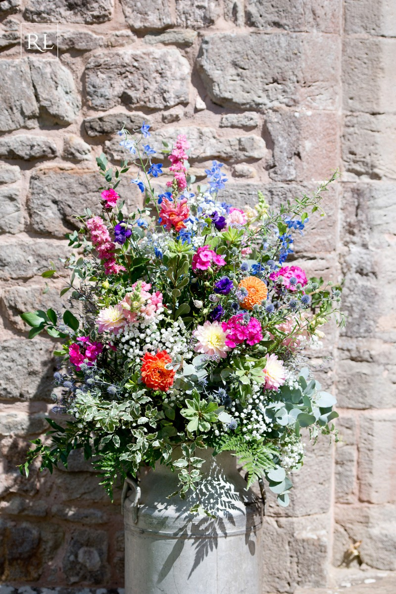 vintage milk churn flowers for a colourful wedding at Homme House