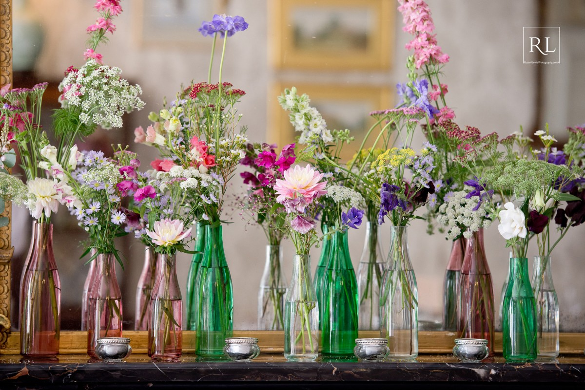 mantlepiece flowers for a colourful wedding at Homme House