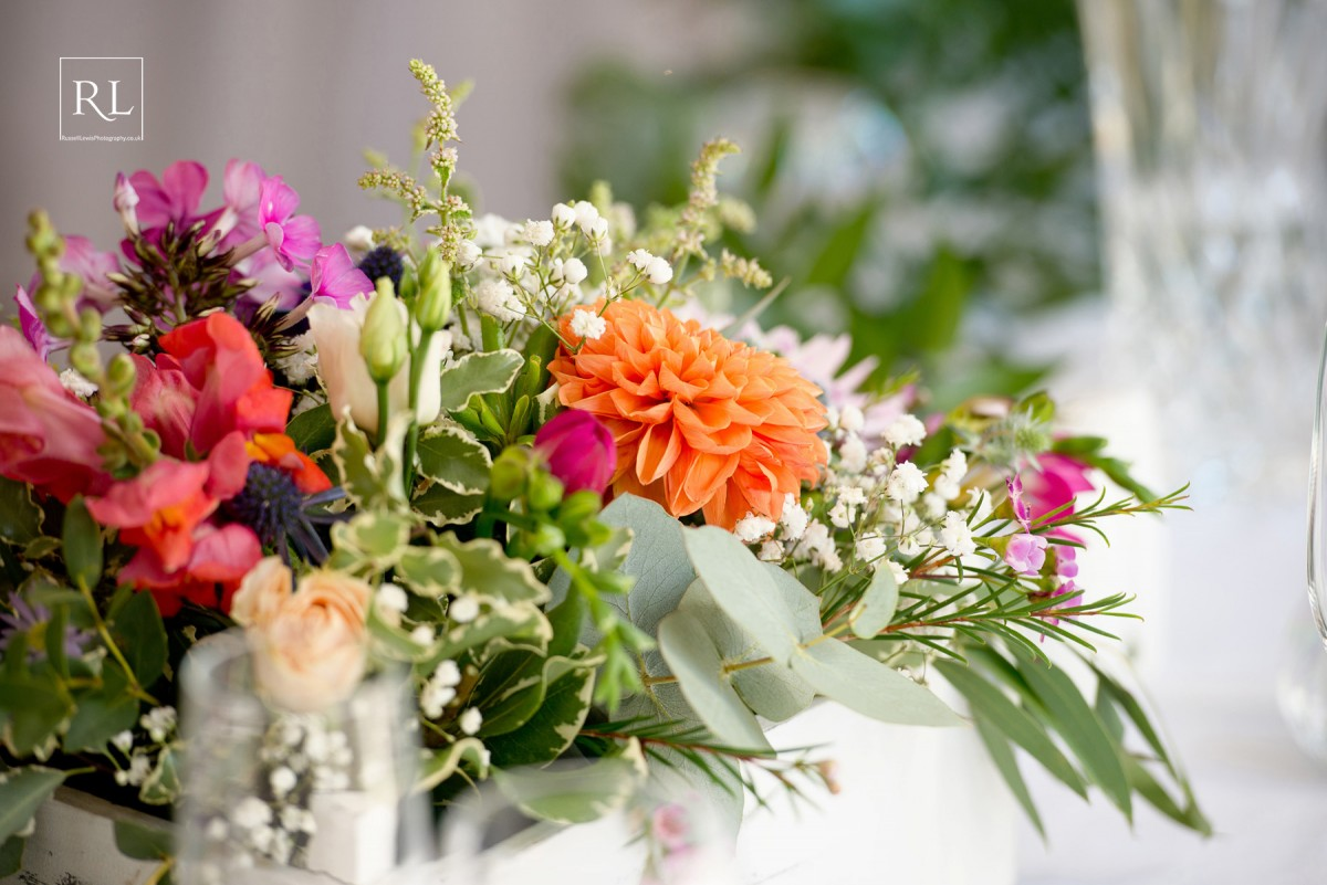 table flowers for a colourful wedding at Homme House