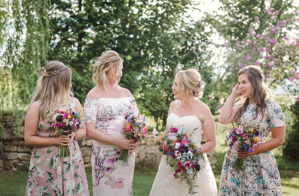 bride bridesmaids bouquets colourful summer wedding Deer Park Hall