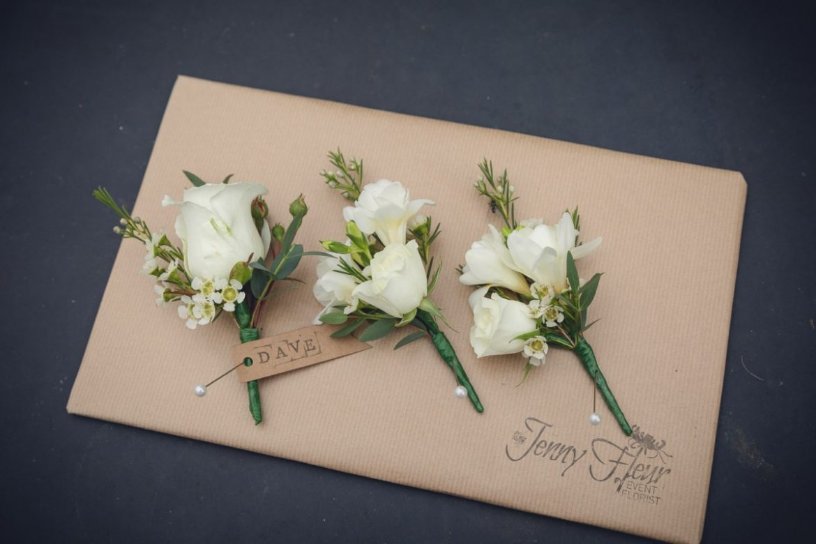white rose buttonhole corsage