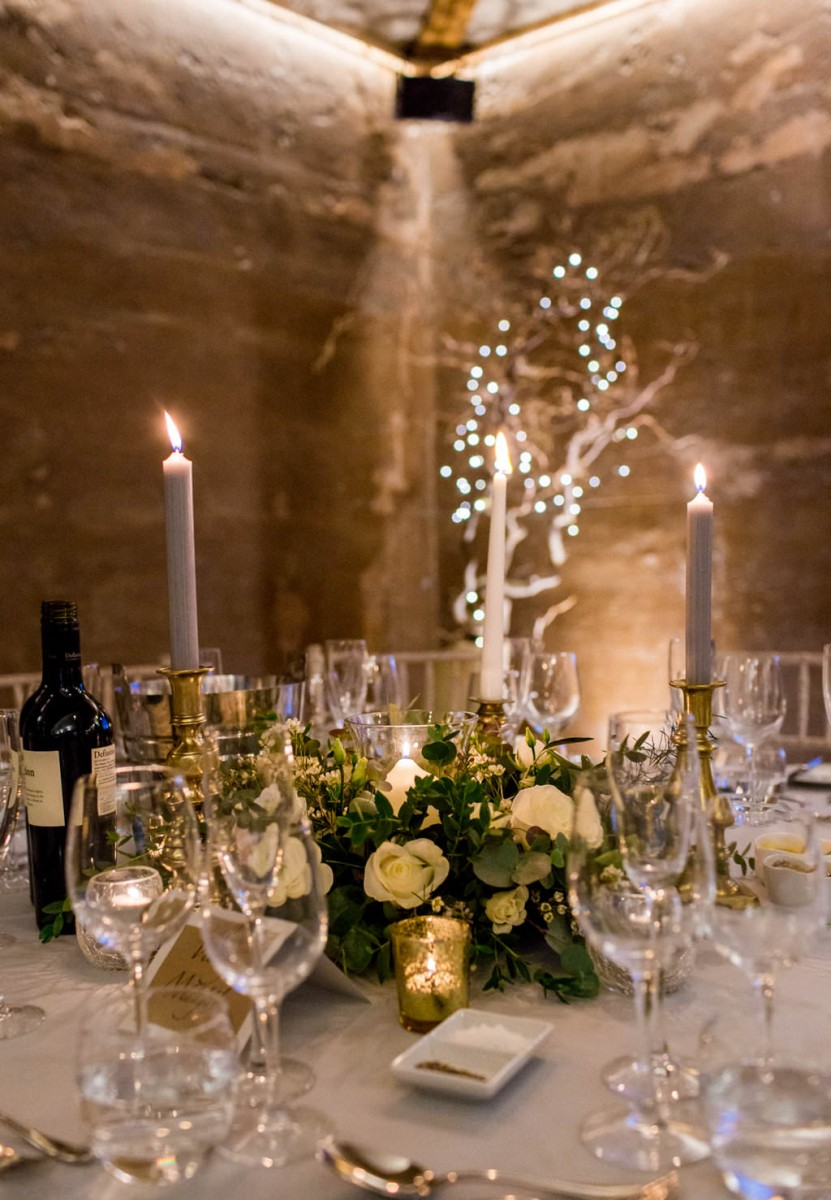 white and green winter wedding table centre