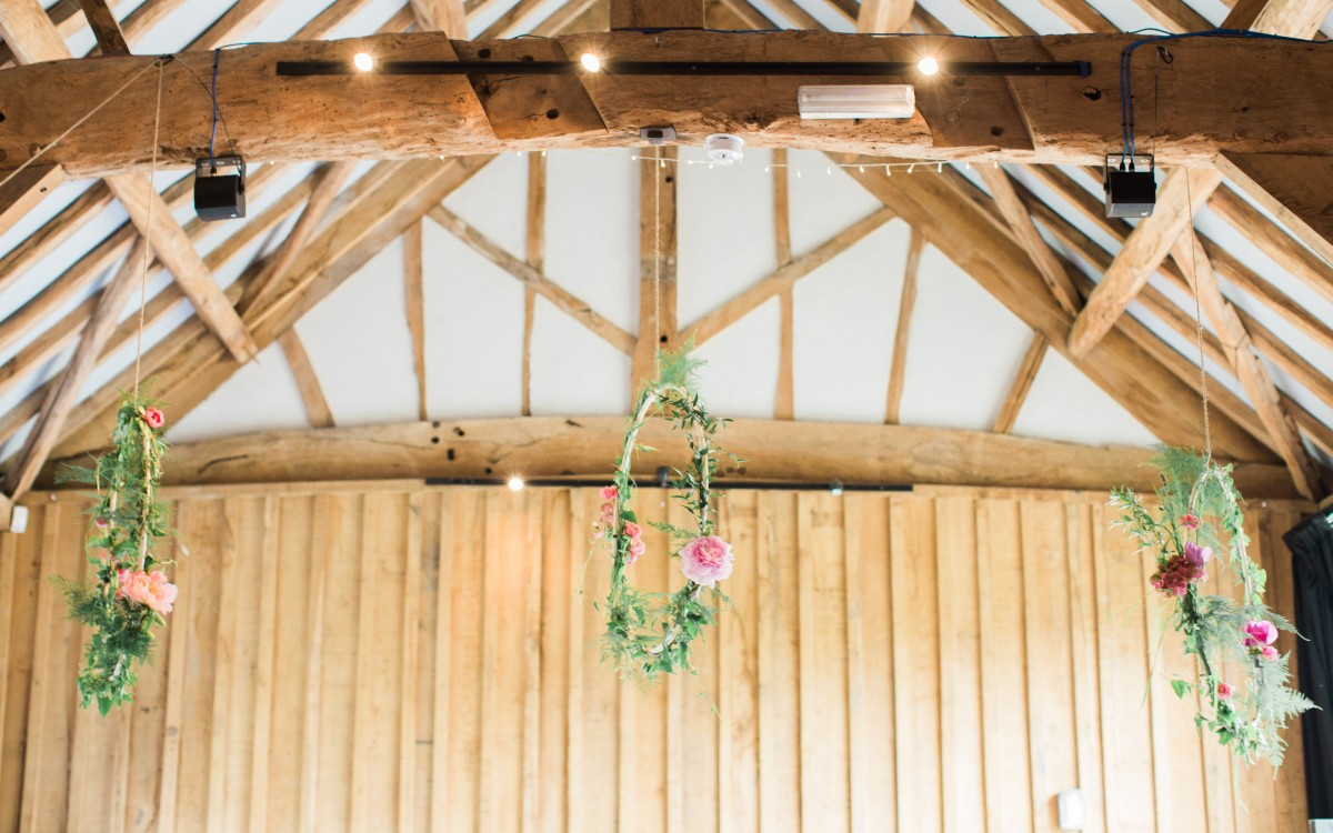 hanging hoops of flowers and foliage