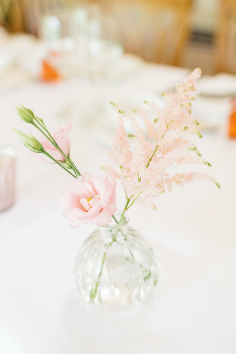 bud vases of pale pink flowers