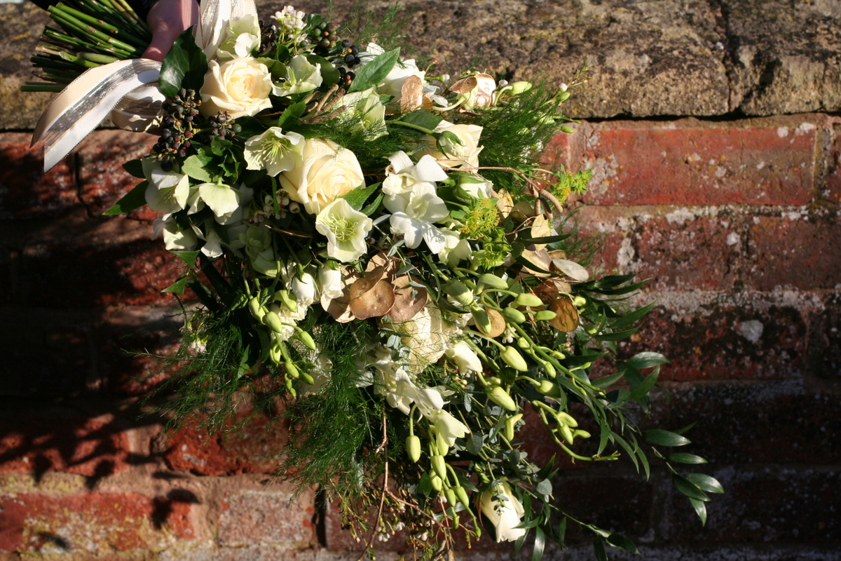 gold and ivory winter wedding brides bouquet