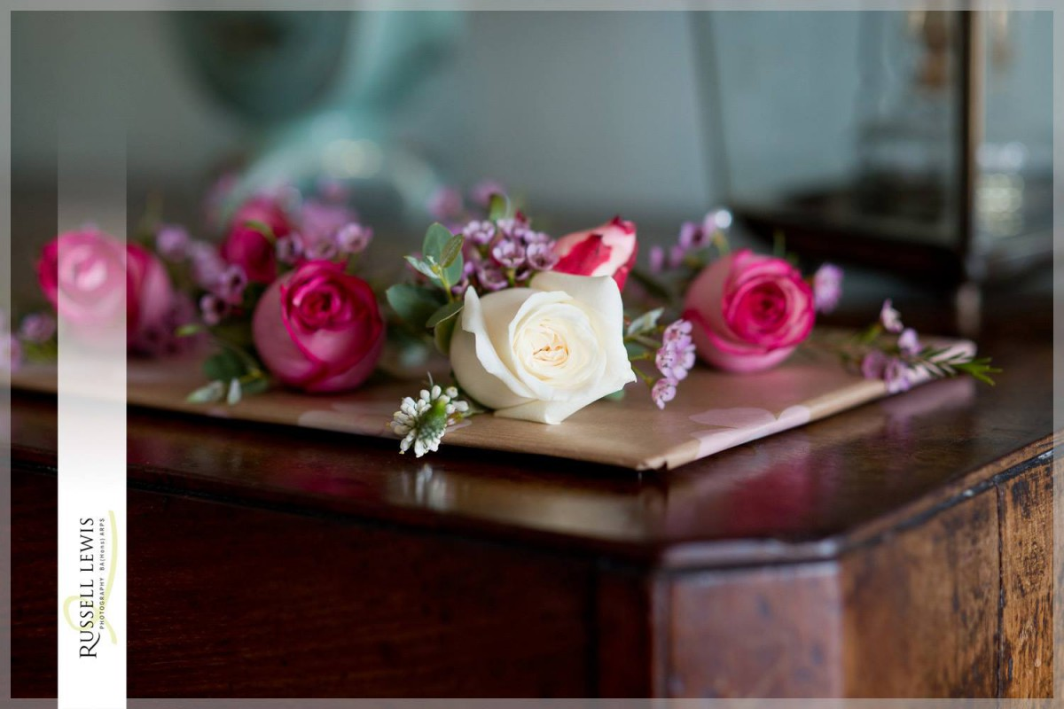 raspberry pink and ivory rose buttonhole
