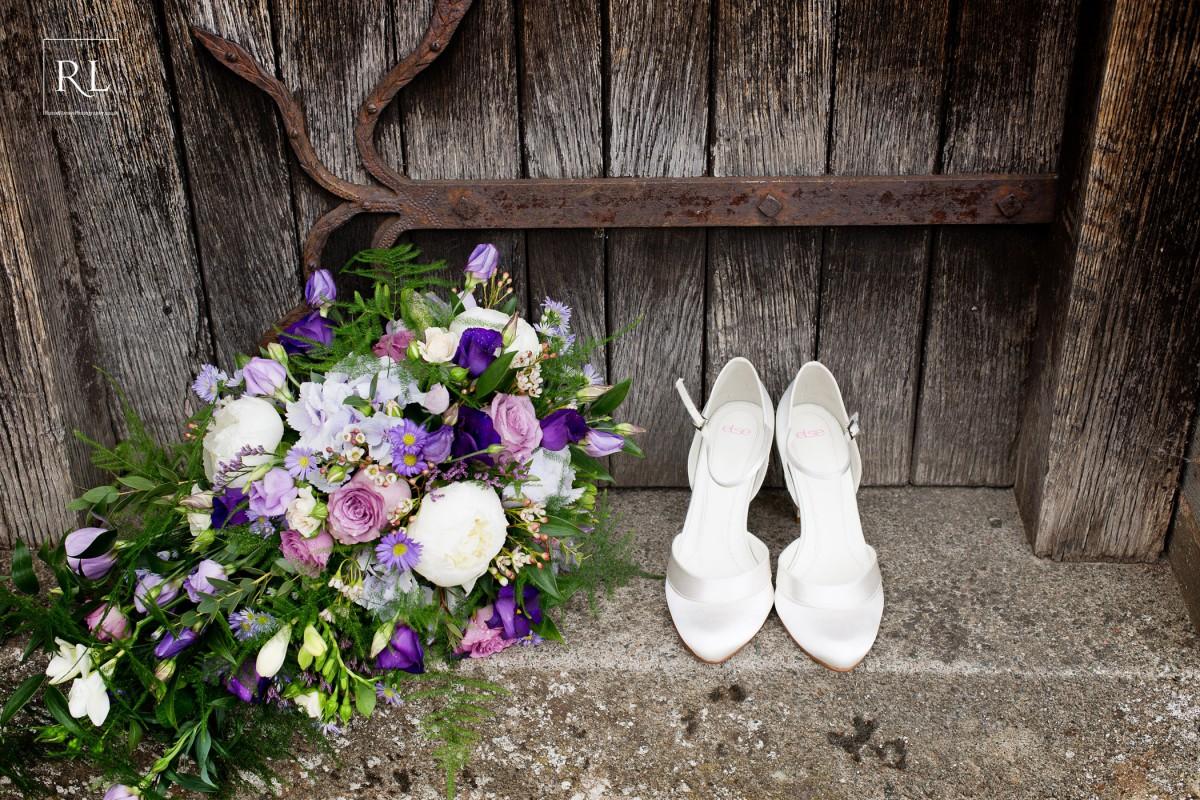 trailing brides bouquet with purple flowers