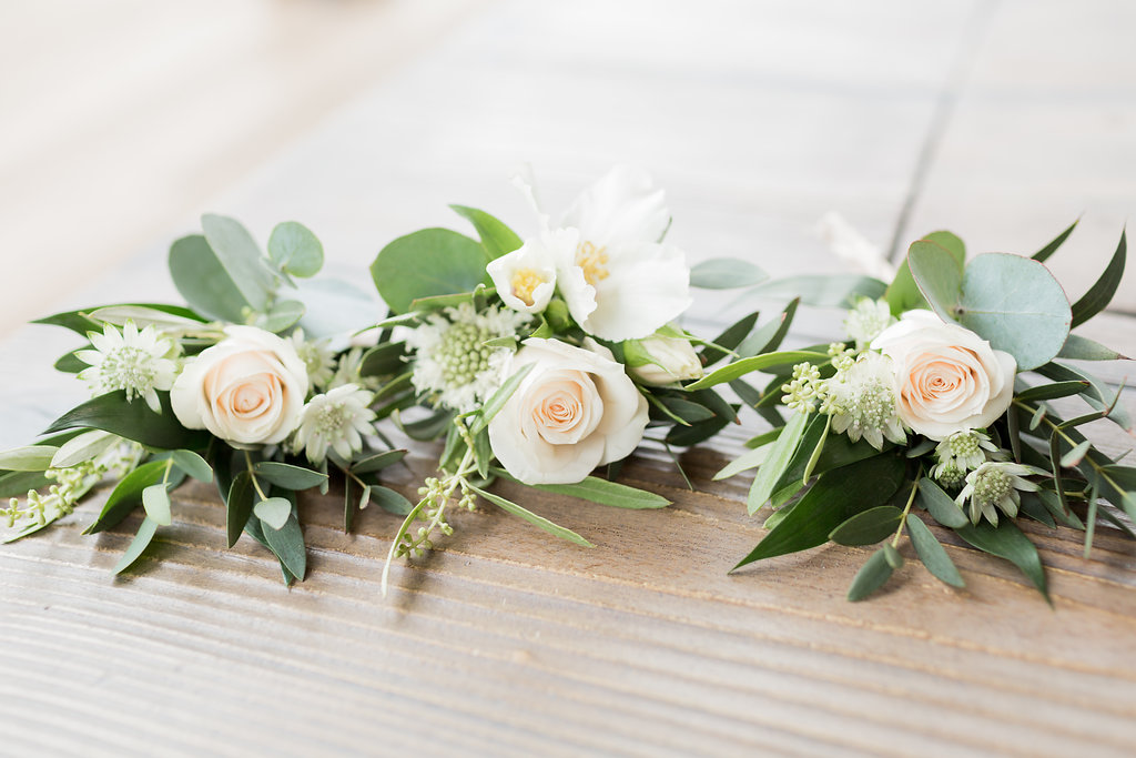 rose and foliage buttonholes