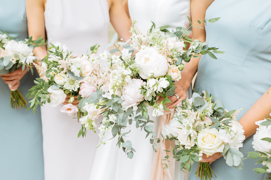 Bride and bridesmaids bouquets for a summer wedding at Mill Barns wedding venue